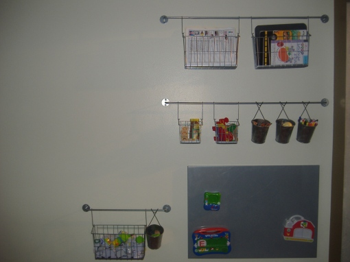 This is our school wall.  It has a magnet board for the Leap Frog toys.  Also, it hold all the markers, crayons etc.