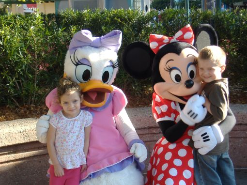 Grace with Daisy Duck and Isaac with Minnie Mouse