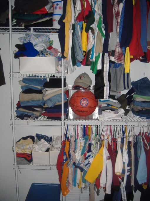 Here is part of the boys closet.  Owen's shirts are on the bottom right and Isaac's the upper right.  On the bottom left is 2 bins (not seen in this photo) that hold P.J's and under clothes for Isaac.  On the shelves are little baskets for Owen's socks and undershirts, then his pants are above.  Then Isaac's are above that.