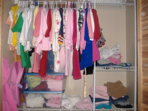 Having one child in a closet is a lot easier to organize and keep neat.  This is Grace's closet.  She has a hanging area on the left, bins for underwear, socks and P.J's under that and then her pants are on the right.  Simple.