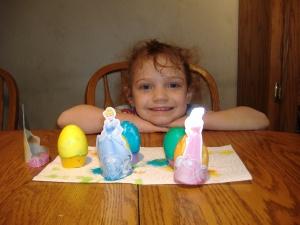 Grace with her princess Easter eggs.