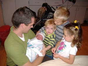 Isaac, Gracelyn and Owen meeting their newest member of the family.