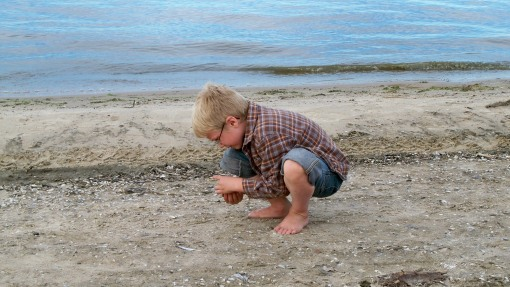Isaac collecting shells